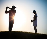 Male and female golfers playing golf Royalty Free Stock Photo