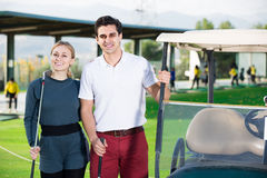 Male and female golfers ready for team play at golf course Royalty Free Stock Photography