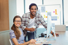 Male and female graphic designers working in conference room Royalty Free Stock Photo