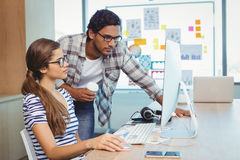 Male and female graphic designers working in conference room Royalty Free Stock Photos