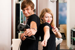Male and female hairdresser Stock Photography