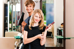 Male and female hairdresser Stock Images