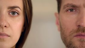 Male and female half face looking into camera, gender equality, opinion poll. Stock footage royalty free stock images