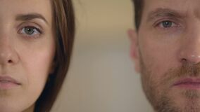 Male and female half face looking into camera, gender equality, opinion poll. Stock footage stock footage