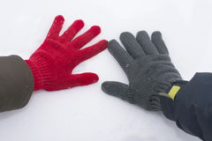 Male and female hand in gloves touching snow Stock Photography