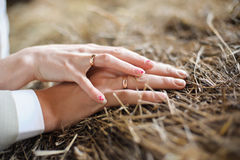 Male and female hand on straw royalty free stock photo