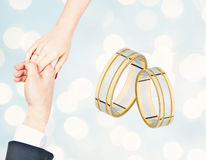Male and female hand with a wedding ring. Place for copy space Royalty Free Stock Photos