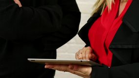 Male and female hands demonstrating ipad tablet app stock footage