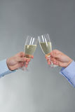 Male and female hands with glass of champagne Stock Photo