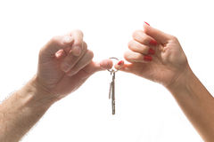 Male and female hands hold a bunch of keys. Stock Photo
