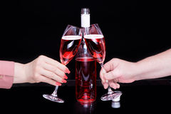 Male and female hands hold glasses with red wine Stock Images