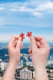 Male and female hands with little puzzle pieces Royalty Free Stock Photos