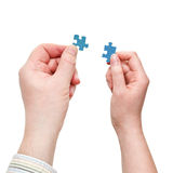 Male and female hands with little puzzle pieces Stock Images