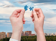 Male and female hands with little puzzle pieces Royalty Free Stock Photography