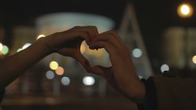 Male and female hands making heart shape sign, romantic story of eternal love. Stock footage stock video footage