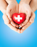 Male and female hands with red heart Stock Photo