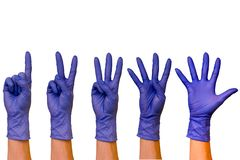 Male or female hands in rubber gloves of different colors isolat royalty free stock images