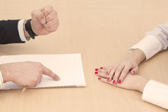 Male and female hands on the table royalty free stock images