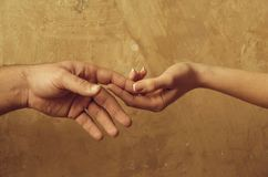 Male and female hands touching each other royalty free stock photos