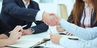 Male and female handshake in modern office. Serious business and partnership concept. Partners made deal, sealed with. Male and female handshake in office stock photos
