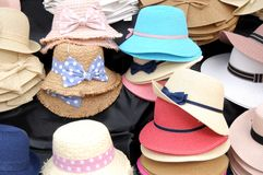 Men`s and women`s hats on display in the village of Iseo on the Stock Image