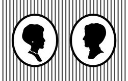 Male and female head portraits in frames on the wall with jewelry profile silhouettes, vector. Illustration Stock Images