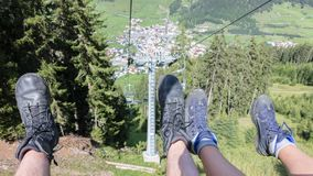 Male and female hiker riding a chairlift stock photo