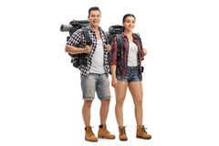 Male and female hikers with backpacks standing and looking at th stock image