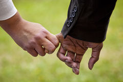 Male and Female Holding Hands Royalty Free Stock Image
