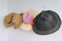 Holiday Hats Hang on a Wall stock photo