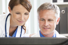 Male Female Hospital Doctors Using Computer Royalty Free Stock Photo