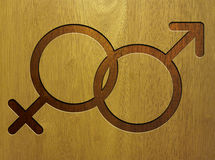 Male and female icon on wood. Male and female gender symbols on wooden background. Sex symbols on wood Royalty Free Stock Photo