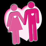 Male & female icons in love. An icon couple hand in hand in front of a big heart Royalty Free Stock Image