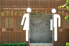 Male and female icons. In front of an entrance of a public toilet, simple, modern, and functional stock images