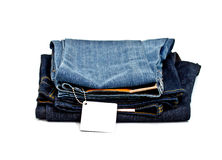 Male and female jean with blank tag. On white background Royalty Free Stock Images