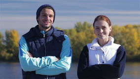 Male and female joggers smiling at the camera stock video footage