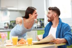 Male and female in kitchen in the morning royalty free stock photography