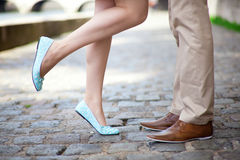 Male and female legs. During a date Stock Photography