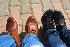 Male & female legs in boots Stock Photography