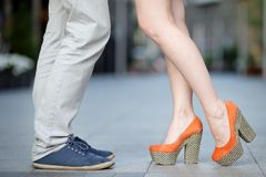 Male and female legs during a date Stock Images