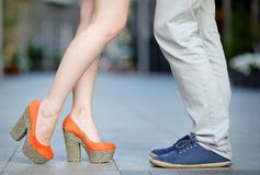 Male and female legs during a date Stock Image