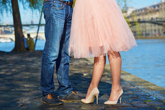 Male and female legs during a date. Closeup of male and female legs during a date. Romantic couple kissing on the Seine embankment in Paris royalty free stock photography