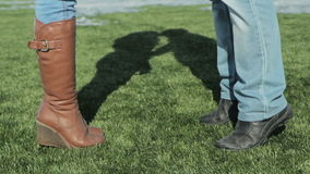 Male and female legs on the football football stock video