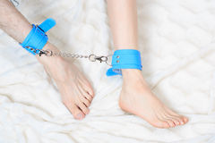 Male and female legs in handcuffs. couple in bed Royalty Free Stock Photography
