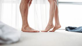Male and female legs, intimate games in bedroom. Couple intimacy, intimate desire of passionate partners Stock Photography