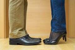 Male and female legs during a kiss Stock Photography
