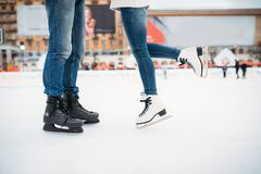 Male and female legs in skates, couple on the rink. Male and female legs in skates, love couple on the rink. Winter skating on open air, active leisure, ice Stock Photography