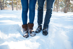 Male and female legs standing in winter park Royalty Free Stock Image