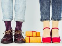 Male and female legs in stylish shoes stock photos