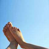 Male and female legs in summer. Male and female foot high direction sky Royalty Free Stock Photos